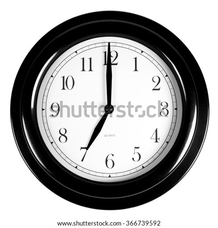 Seven o'clock on the black wall clock, isolated on white background - stock photo
