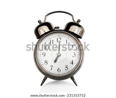 Seven on an old vintage alarm clock isolated on white background