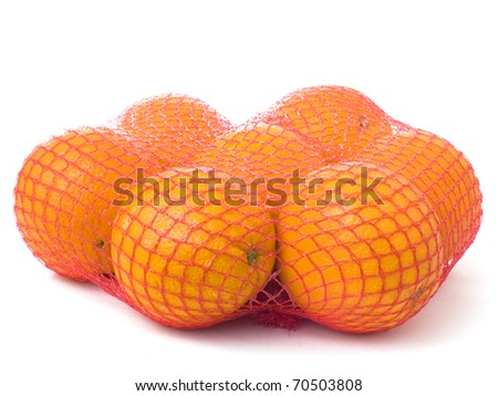 Seven oranges in a red net isolated on white background