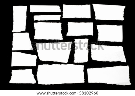 Seven pieces of paper on black - stock photo