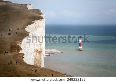 Seven Sisters National Park, view of the cliffs, lighthouse and the beach, East Sussex, England - stock photo