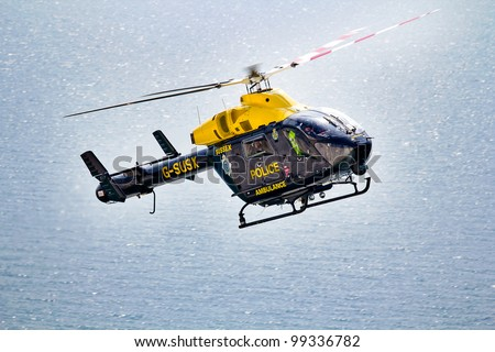 SEVEN SISTERS, UK - AUGUST 1: The Sussex police helicopter patrols over the Seven Sisters cliff tops on the south coast on 1 August, 2011. - stock photo