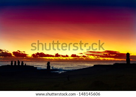 Seven standing moais at sunset in Easter Island - stock photo