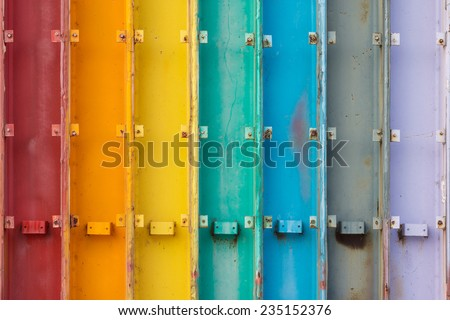 Seven Steel Beams Painted in Rainbow Color. - stock photo