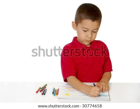 seven-year-old boy coloring with crayons - stock photo