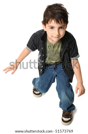Seven year old boy dancing over white background.