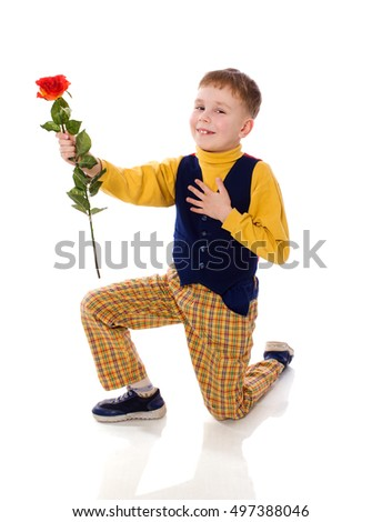 Seven years boy giving rose standing on one knee isolated