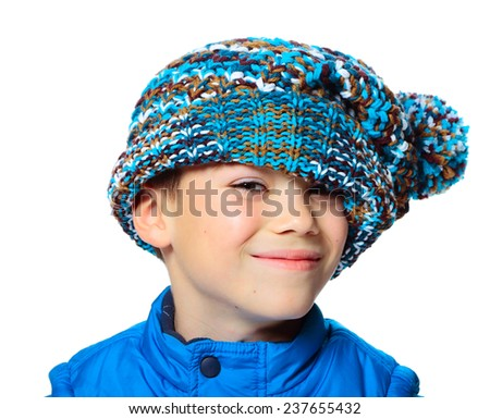 Seven years boy with stylish hat on his face isolated on white background - stock photo