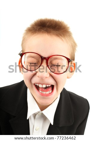 seven years old boy grimacing and make funny face isolated on white