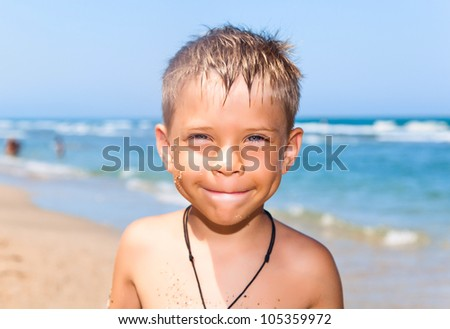 seven years old boy on the beach - stock photo