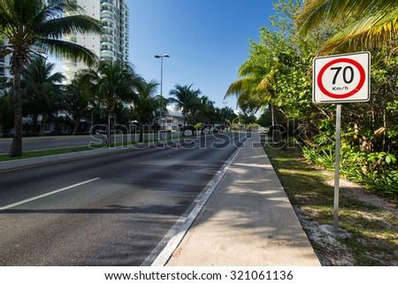 Seventy kilometers per hour speed limit on caribbean street road  - stock photo