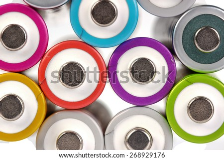 Several AA batteries in perspective closeup view on white background - stock photo