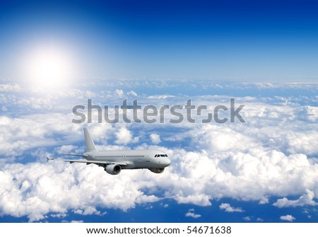 Several aircraftes in blue sky - stock photo