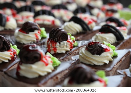 Several appetizing cakes of different flavors and colors. - stock photo