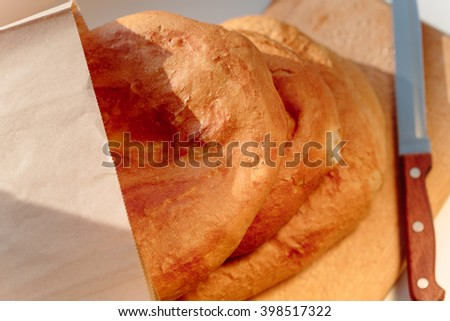 Several armenian homemade bread mantakash in a paper bag. Colorful photo.