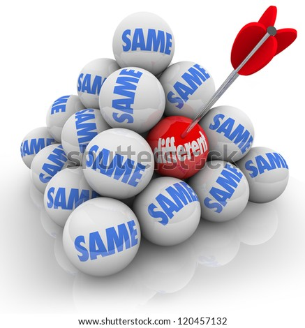several balls in a ball pyramid marked Same and one with the word different targeted by an arrow to symbolize change and innovation - stock photo