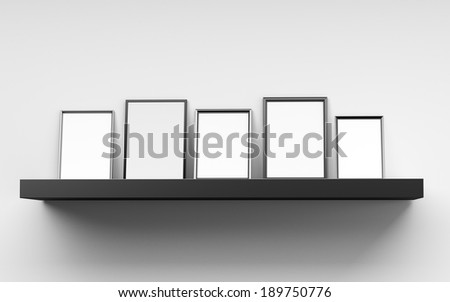several blank frames from front leaned against a wall - stock photo