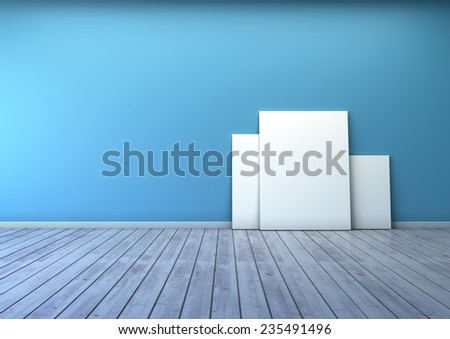 several blank picture in the blue wall room and wooden floor  - stock photo
