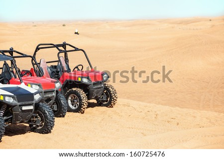 Several buggies in the desert. - stock photo