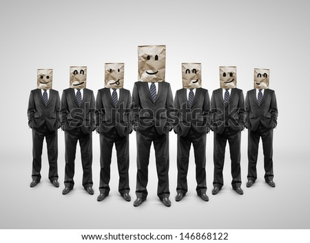 several businessman standing with paper bag on head - stock photo