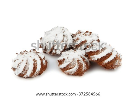 several chocolate mouthwatering shortbread cookies with powdered sugar isolated on white background - stock photo