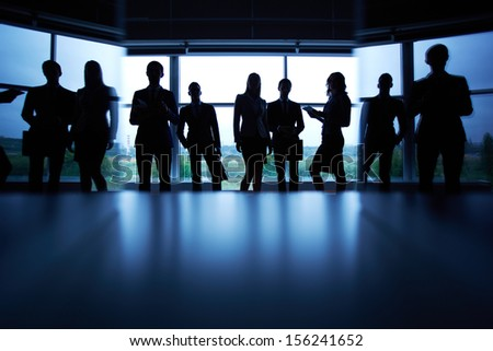 Several colleagues outlines against window - stock photo