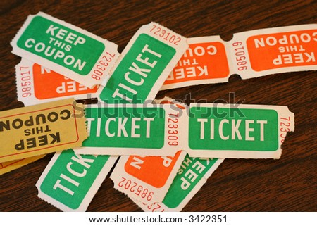 Several colored admission tickets