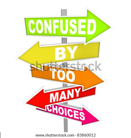 Several colorful arrow street signs with the words Confused By Too Many Choices, illustrating the paralysis and immobility you can feel when suddenly facing a wide array of options to choose from - stock photo