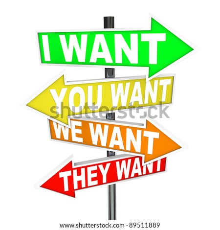 Several colorful arrow street signs with the words I Want, You Want, We Want, They Want representing a dispute or differences in desires and what we should prioritize - stock photo