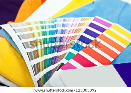 several colorful t-shirts and color scale - stock photo