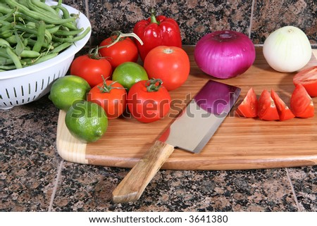 Several colorful vegetables on a cutting board - stock photo