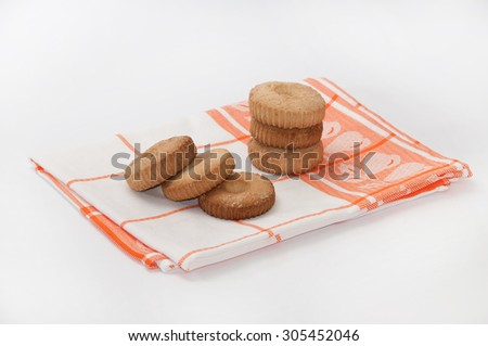 Several cookies on dish towel. - stock photo
