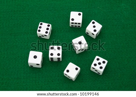 several dice over a green table - stock photo