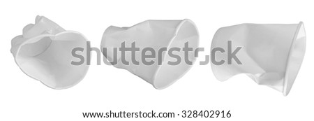 several different dented disposable tableware paper cups. Garbage. isolate - stock photo