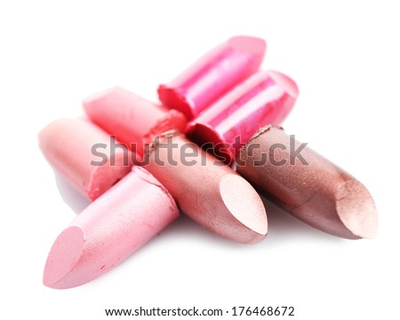 Several different lipsticks isolated on white