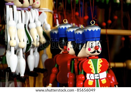Several different wooden Jumping Jacks hanging in an oldfashioned toy shop - stock photo