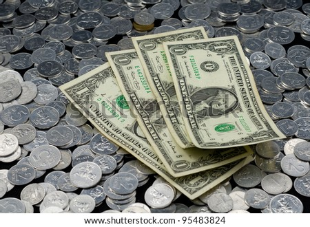 Several dollar banknotes on the coins background. - stock photo