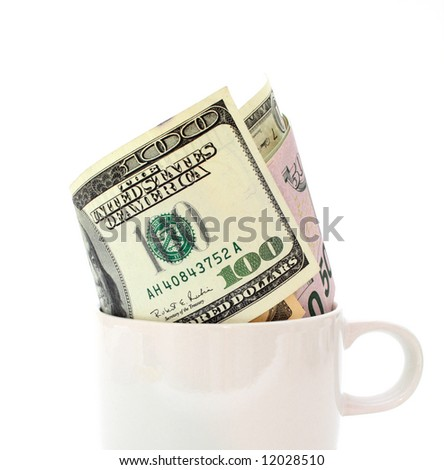several dollar bills inside a white cup