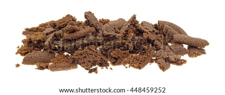Several Dutch cocoa cookies crumbled into pieces isolated on a white background. - stock photo