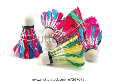 Several feather colourful shuttlecocks on white background, isolated - stock photo