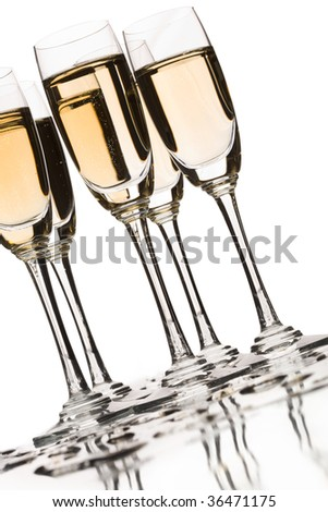 Several flutes of champagne over white background - stock photo