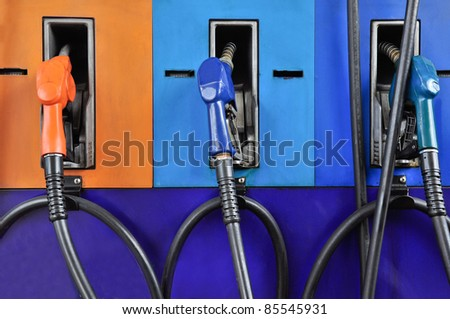 Several gasoline pump nozzles at petrol station, gasoline industry