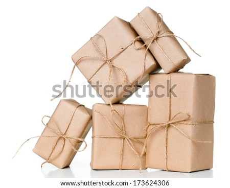 Several gift boxes, postal parcels wrapped in brown kraft paper tied with a rope on a white background, isolated