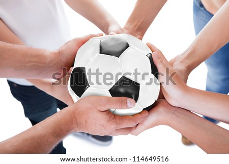 Several Hands Holding Together Soccer Ball Isolated On White Background - stock photo