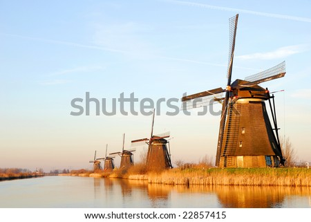 Several historical windmills in a row. - stock photo