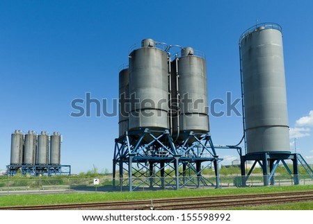several industrial processing tanks for the chemical industry - stock photo