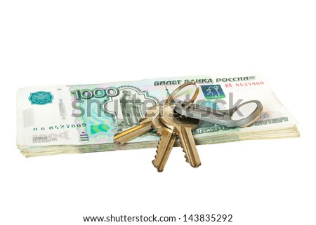 Several keys on heap of money. Concept of real estate buying, shopping. Isolated. - stock photo