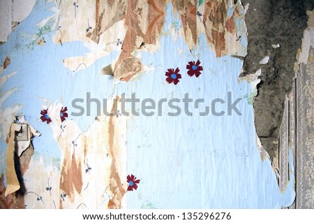 Several layers of the old torn wallpapers in a room - stock photo