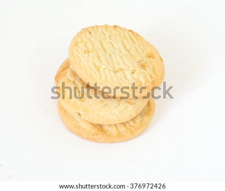 Several macadamia nut cookies on a white background.  - stock photo
