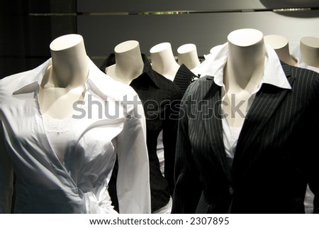 Several mannequins without a head. Can be used to illustrate stupidity, thoughtlessness or a herd-like mentality. - stock photo